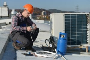 Coles refrigeration's technician repairing air conditioner